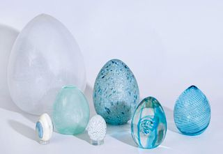 GROUP OF SIX GLASS EGGS AND A PAINTED MARBLE EGG