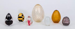 GROUP OF SEVEN GLASS EGGS