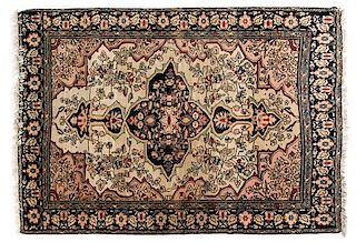 A Sarouk Farahan Wool Rug 4 feet 7 inches x 3 feet 5 inches.