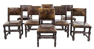 A Group of Eight French Renaissance Revival Oak Chairs Height 37 inches.