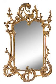 A Rococo Style Giltwood Mirror Height 40 x width 25 1/4 inches.