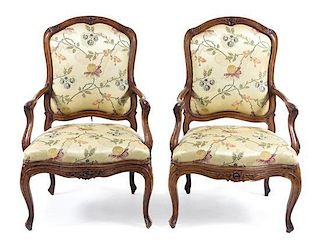 * A Pair of Louis XV Walnut Fauteuils Height 41 1/2 inches.