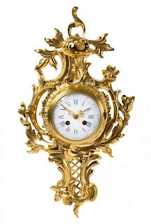 * A Rococo Style Gilt Bronze Cartel Clock Height 21 inches.