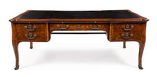 * A Louis XV Style Kingwood and Parquetry Bureau Plat Height 30 1/2 x width 78 1/2 x depth 41 1/4 inches.