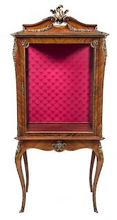 * A Louis XV Style Gilt Metal Mounted Rosewood Vitrine Height 78 3/4 x width 33 1/4 x depth 17 7/8 inches.