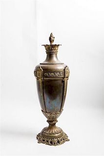 An Ornamental Gilt Metal Urn