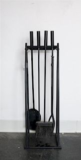 An Assembled Set of Metal Fireplace Tools Height of stand 31 inches.