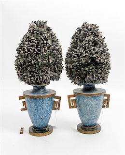 * A Pair of Painted and Parcel Gilt Wood Urns Height 16 inches.