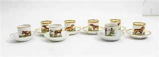 * A Collection of Paris Porcelain Cup and Saucer Sets Height of cups 2 1/2 inches.