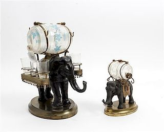 * A Cast Metal and Brass Elephant Form Decanter Set Height of first overall 12 1/2 inches.