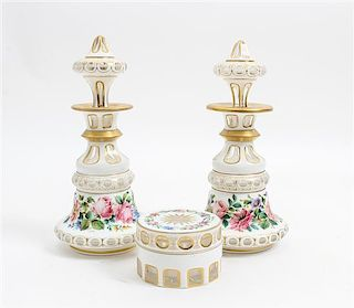 * An Assembled Cased Glass Dresser Set Height of pair 10 inches.