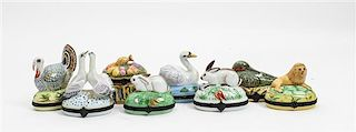 * Eight Limoges Porcelain Boxes Height of tallest 4 inches.