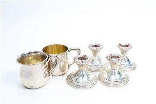 * Four American Silver Candlesticks Height of tallest 2 1/2 inches.