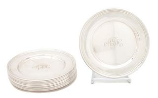 A Set of Twelve American Silver Bread Plates, , each engraved with a script monogram.