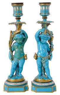 Pair Sevres Style Putti Form Candlesticks
