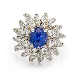 A 14 Karat White Gold, Sapphire and Diamond Ring, 4.90 dwts.