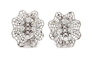 A Pair of 14 Karat White Gold and Diamond Earclips, 8.40 dwts.