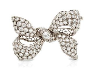 * A Platinum and Diamond Bow Brooch, 11.60 dwts.