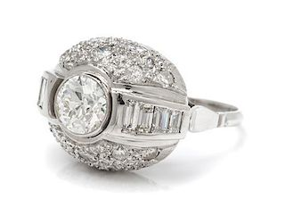 An Art Deco Platinum and Diamond Bombe Ring, 6.20 dwts.