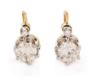 A Pair of Platinum Topped 14 Karat Yellow Gold and Diamond Earrings, 3.60 dwts.