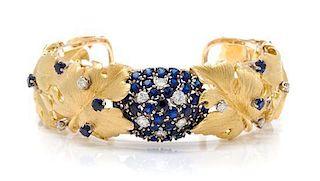 An 18 Karat Yellow Gold, Sapphire and Diamond Leaf Motif Cuff Bracelet, Erwin Pearl, 35.30 dwts.