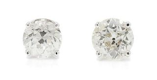 A Pair of White Gold and Diamond Stud Earrings, 1.20 dwts.