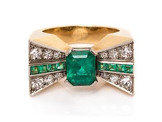 A Platinum Topped Yellow Gold, Emerald and Diamond Bow Motif Ring, 7.10 dwts.