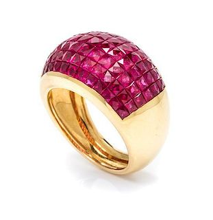 An 18 Karat Yellow Gold and Invisibly Set Ruby Ring, 7.70 dwts.