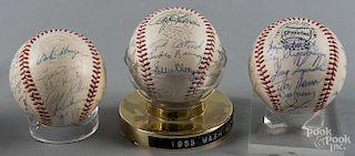 Three signed team baseballs