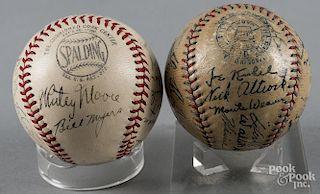 Two signed team baseballs