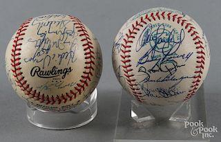 Two team signed baseballs