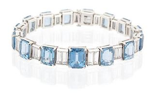 A Faux Aquamarine and Cubic Zirconia Line Bracelet Length 7 inches.