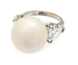 A Faux Pearl and Cubic Zirconia Silvertone Ring