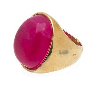 A Pink Cabochon and Goldtone Ring