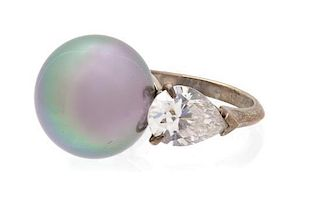 A Faux Tahitian Pearl and Cubic Zirconia Silvertone Ring