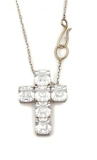 A Silvertone and Cubic Zirconia Cross Chain Length of chain 16 1/2 inches.