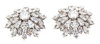 A Pair of Marquise, Pear and Round Cut Pave Brooches Diameter 1 inch.