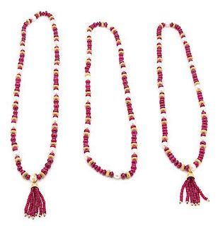 Three Faux Pearl, Pink and Gold Beaded Necklaces with Tassels Length of longest 37 inches.