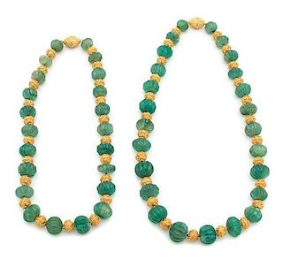 Two Carved Green and Gold Beaded Necklaces Length of longest 26 inches.