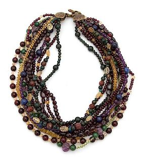 A Stephen Dweck Multi Strand Carved Multicolor Bead Necklace Length of longest 17 1/2 inches.