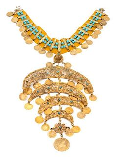 An Indian Goldtone Coin and Turquiose Beaded Choker Height 12 inches.