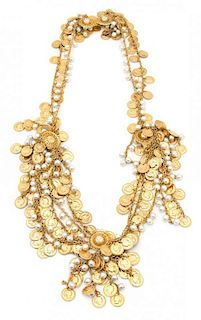 A Goldtone Multi-coin and Faux Pearl Belt Length 37 inches.