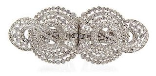 A Silvertone and Cubic Zirconia Convertible Brooch Width 3 3/4 inches.