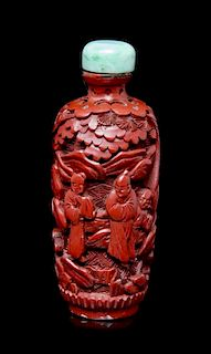 A Carved Cinnabar Lacquer Snuff Bottle, Height of bottle 3 inches.