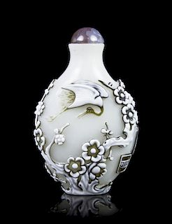 A Carved Glass Snuff Bottle, Height 2 5/8 inches.