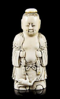 A Carved Ivory Figural Snuff Bottle, Height overall 3 3/8 inches.