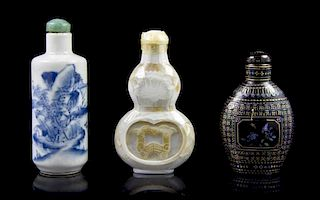 A Group of Three Snuff Bottles, Height of first overall 2 5/8 inches.