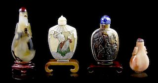 A Group of Four Snuff Bottles, Height of tallest 3 1/4 inches.