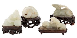 FOUR CHINESE WHITE JADE FIGURES ON STANDS (LATE QING DYNASTY)