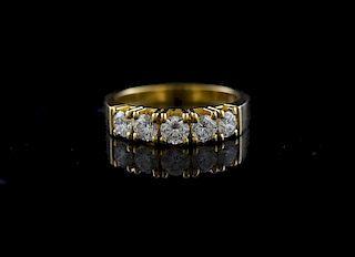 Stamped 18k yellow gold five stone diamond ring